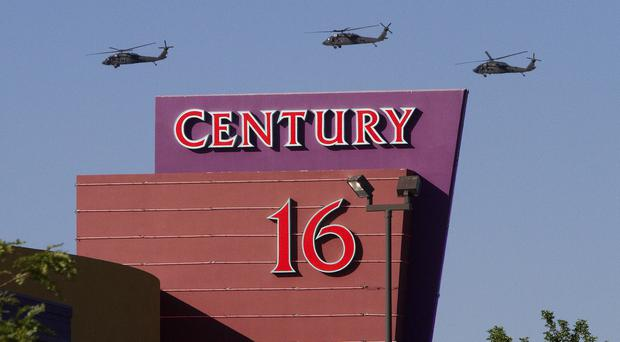 Helicopters fly over the Century Theatre in Aurora, Colorado, a day after 12 people were killed and dozens injured during a showing of the Batman movie The Dark Knight Rises (AP)