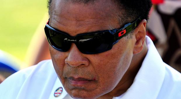 Boxing great Muhammad Ali is in hospital after developing pneumonia