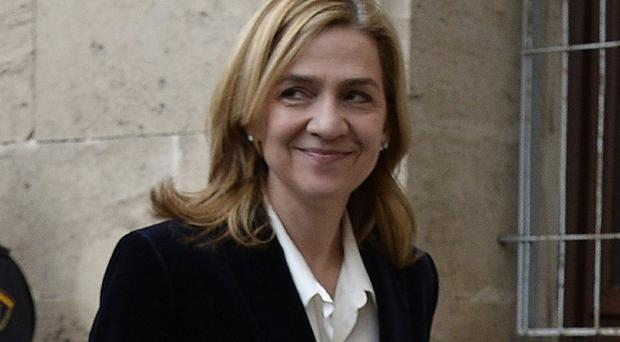Princess Cristina is set to be tried along with her husband on charges of tax fraud (AP)