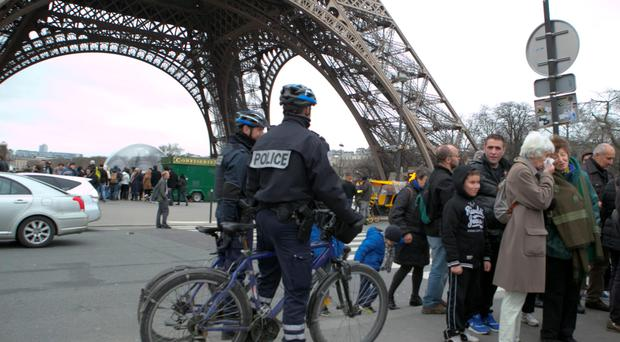 Police on alert in Paris after people were injured in incidents in three other major French cities