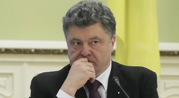 Petro Poroshenko initiated a vote in which Ukraine's parliament voted to abandon the country's non-aligned status. (AP)