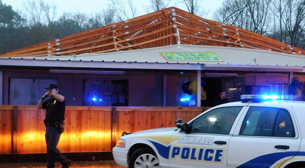 Police inspect Kid's Kampus, a daycare centre after a tornado ripped the roof off of the building in Sumrall, Mississippi (AP/The Hattiesburg American)