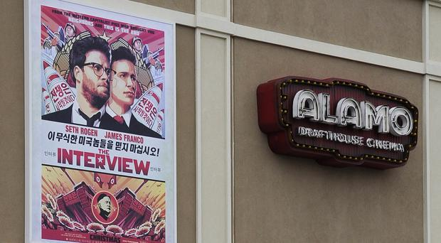 A poster advertising The Interview hangs on the wall of the Alamo Drafthouse Cinema in Houston (AP)