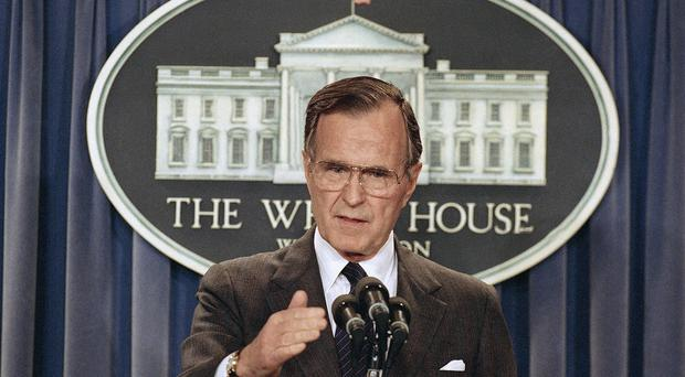 President George HW Bush, pictured in 1989 briefing reporters at the White House, has been taken to hospital (AP)
