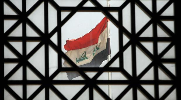 At least 13 people have been killed in a suicide attack near Baghdad