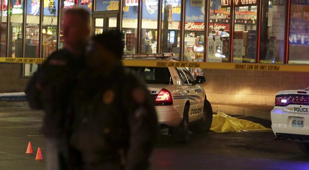 Police stand guard following a shooting in Berkeley (AP/St Louis Post-Dispatch, David Carson)