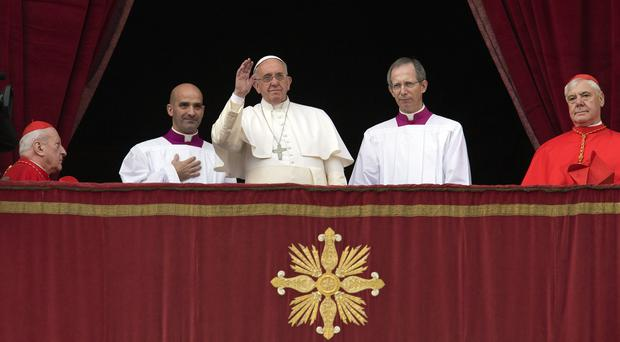 Pope Francis delivers his 'Urbi et Orbi' blessing from the central balcony of St Peter's Basilica at the Vatican (AP)