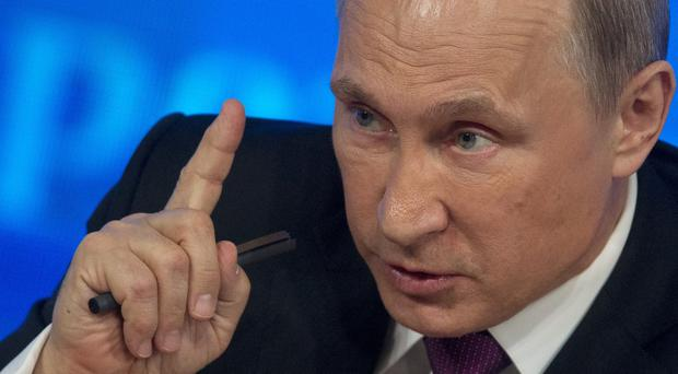 Russian president Vladimir Putin is dealing with an economic crisis (AP)