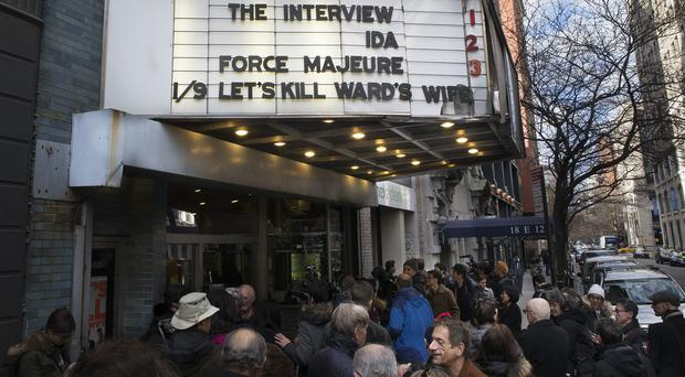 Christmas Day film-goers queue to see The Interview at the Cinema Village in New York (AP)