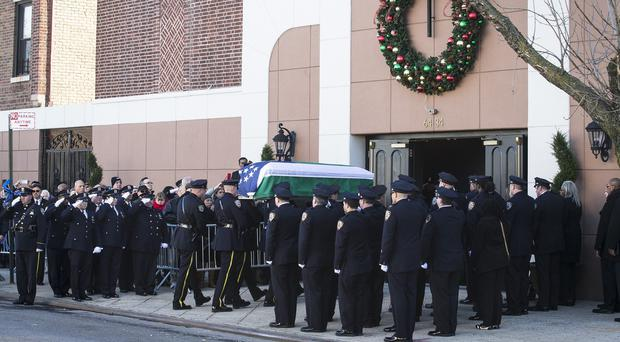 The casket of Rafael Ramos arrives to his wake at Christ Tabernacle Church in the Glendale section of Queens, New York (AP)