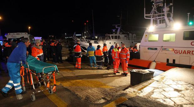 Paramedics near Lecce wait for rescued passengers from the ferry that caught fire (AP)