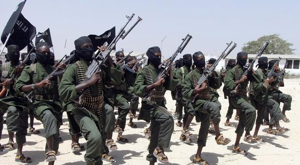 Al-Shabab fighters perform military exercises in Somalia - a US airstrike has targeted a senior leader of the extremist group (AP)