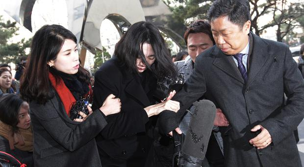 Cho Hyun-ah, centre, arrives at Seoul Western District Prosecutors Office. (AP)