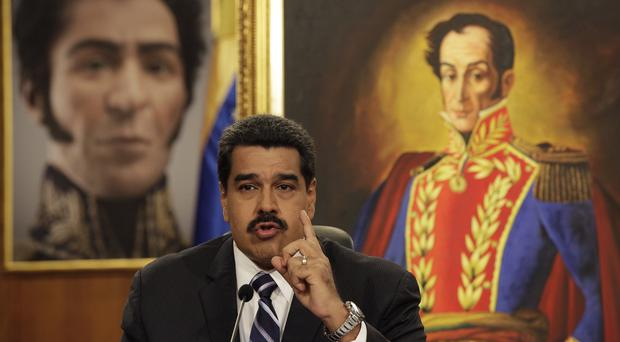 President Nicolas Maduro blamed the economic slump on opponents trying to sabotage activity in oil-rich Venezuela (AP)
