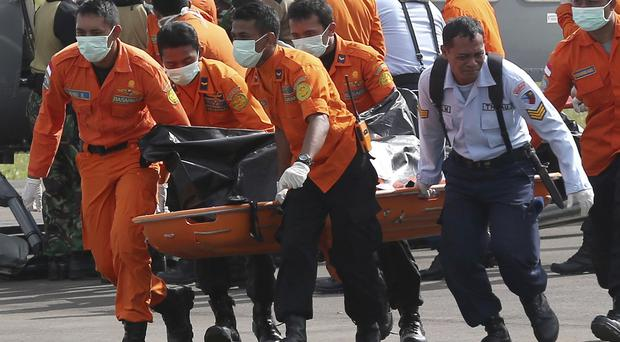 Rescue teams battling monsoon rains have more than tripled the number of bodies pulled from the Java Sea