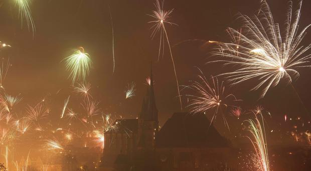 Two people were killed and several others injured in fireworks accidents during New Year celebrations in Germany (AP Photo/Jens Meyer)