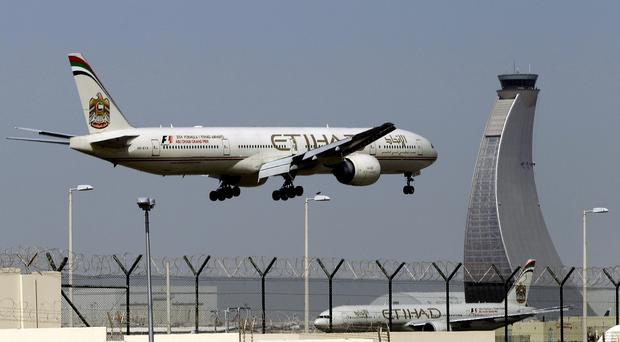 Passengers on an Etihad Airways flight say they were stranded on the tarmac at Abu Dhabi for 12 hours (AP)