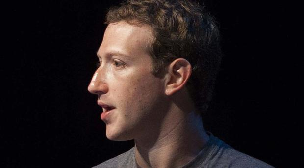 Mark Zuckerberg has vowed to read a book every other week in 2015 (AP)