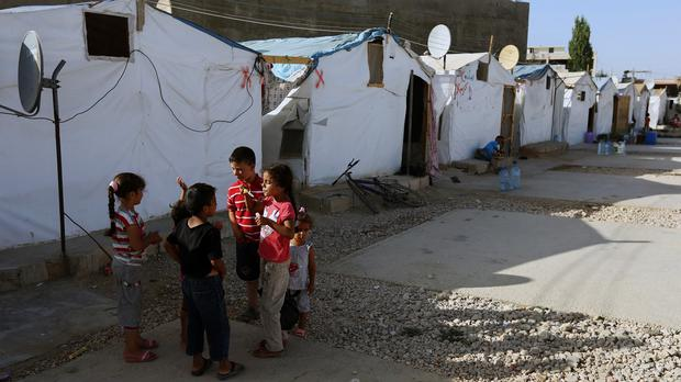 Children play outside their tent in a Syrian refugee camp in the eastern town of Marj, Bekaa valley, Lebanon (AP)