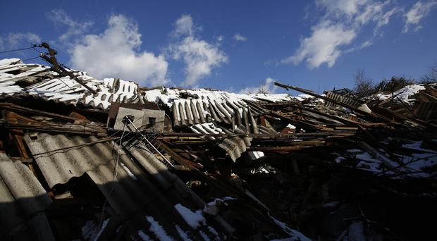 The rubble of houses destroyed by a landslide in the Bosnian town of Kakanj (AP)