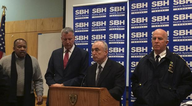 New York City Mayor Billl de Blasio and Police Commissioner William Bratton at a news conference after two New York City police officers were shot while responding to a robbery in the Bronx (AP)