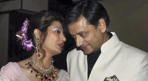 Former Indian junior foreign minister Shashi Tharoor with his wife Sunanda Pushkar at their wedding reception in New Delhi (AP)