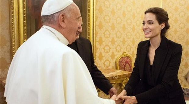 Pope Francis greets Angelina Jolie at the Vatican (AP/L'Osservatore Romano)