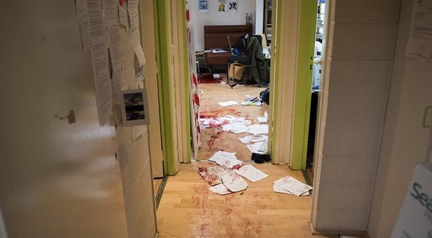 Image from the Charlie Hebdo office shows blood-stained wooden floors, papers strewn across the corridor