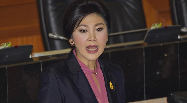 Yingluck Shinawatra answers a question at parliament in Bangkok (AP)