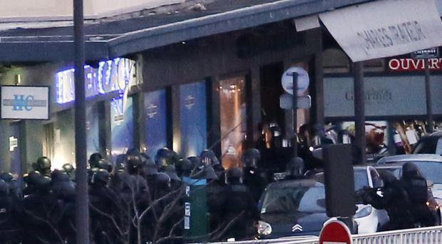 French special forces launch the assault at a kosher grocery store in Porte de Vincennes, eastern Paris