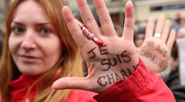 One woman's message: Demonstrators participate in a mass unity rally following the recent Paris terrorist attacks on January 11, 2015 in Paris, France