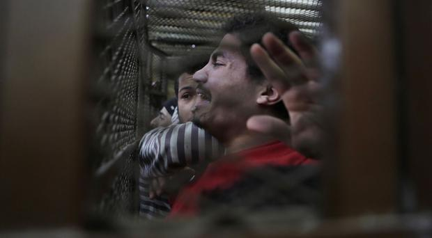 Some of the 26 men arrested in a televised raid last month celebrate after an Egyptian court acquitted them (AP)