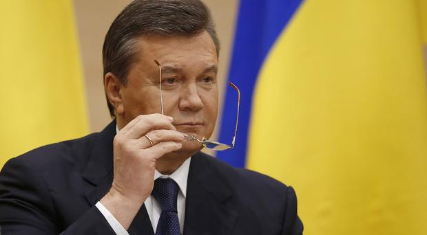 Viktor Yanukovych abandoned his post and fled to Russia last February (AP)