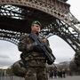 French troops patrol around the Eiffel Tower in Paris