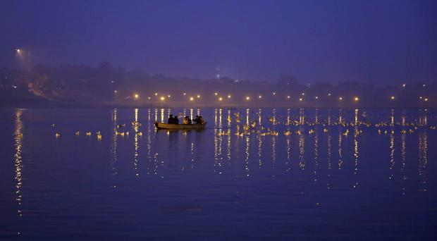 Indian authorities are investigating the discovery of bodies in an offshoot of the River Ganges (AP)