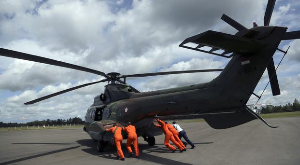 Indonesian search officials have been notified so they can begin recovery operations, a Singapore minister said (AP)