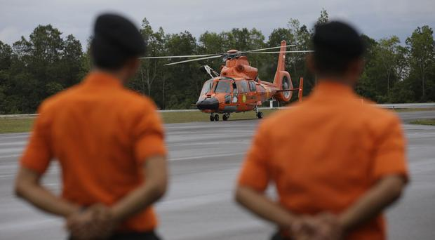 A National Search And Rescue Agency helicopter returns to the airport in Pangkalan Bun, Indonesia. (AP)