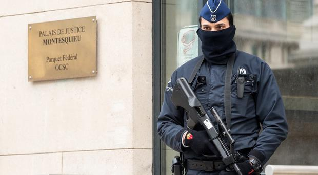 A guard outside the Belgian Federal Prosecutor's office in Brussels. (AP)