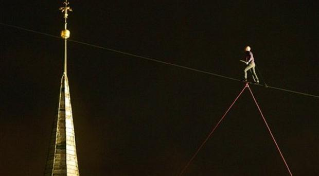 Swiss tightrope acrobat David Dimitri performs his show, a 240 meter long walk between two church towers, during the gala opening of the European Capital of Culture 2015 project (AP/Michal Kamaryt, CTK)