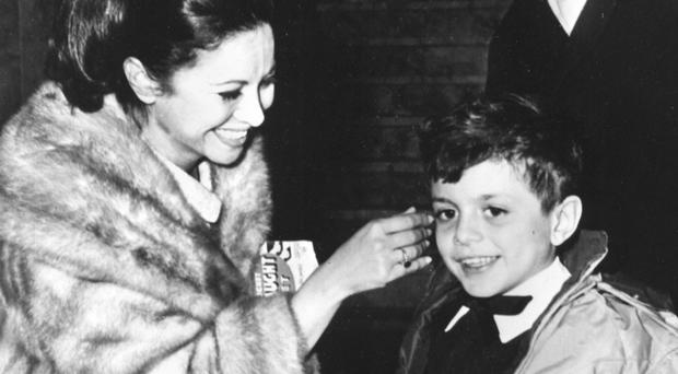 Faten Hamama pictured in 1965 with her son Tarek (AP)