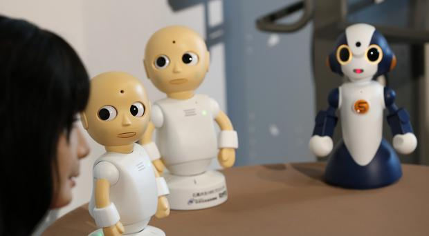 Talking robots CommU and Sota talk with Android robot Otonaroid during a press event at the National Museum of Emerging Science and Innovation Miraikan in Tokyo (AP Photo/Shizuo Kambayashi)
