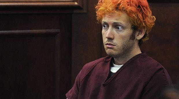 Jurors must decide if James Holmes was insane when he opened fire on movie-goers in July 2012, killing 12 and injuring 70 (AP/Denver Post)