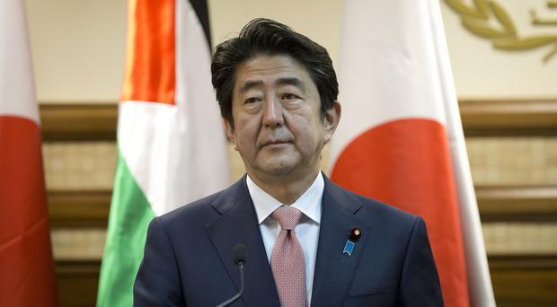 Shinzo Abe said the lives of the two Japanese hostages were the top priority (AP)