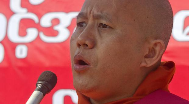 Ultranationalist Buddhist monk Wirathu speaks during a rally over a UN resolution calling on Burma to grant citizenship to Rohingya (AP)