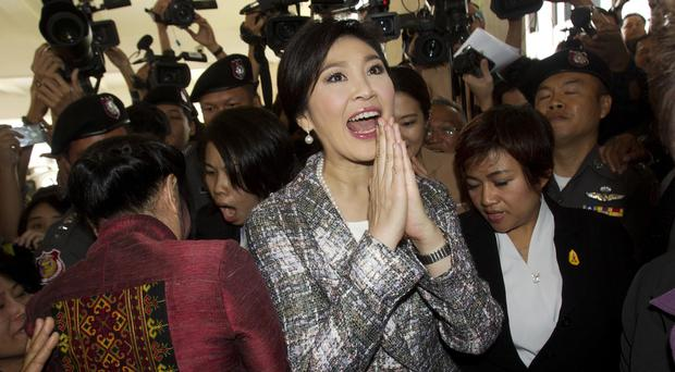 Yingluck Shinawatra leaving parliament in Bangkok (AP)