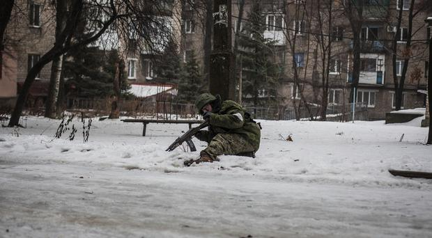 A Russian-backed rebel in a position 3km from Donetsk airport, the scene of fierce fighting