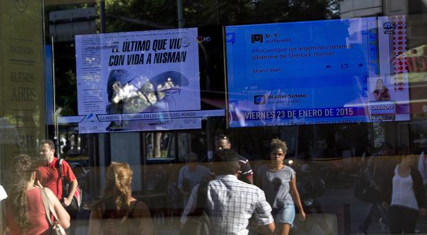 TV screens in Buenos Aires with the news about the death of Alberto Nisman (AP)