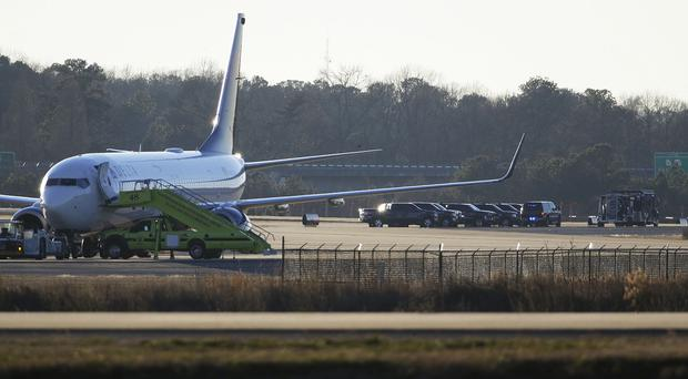 Police and bomb squad vehicles sit behind a Delta jet at Hartsfield-Jackson Atlanta International Airport (AP)