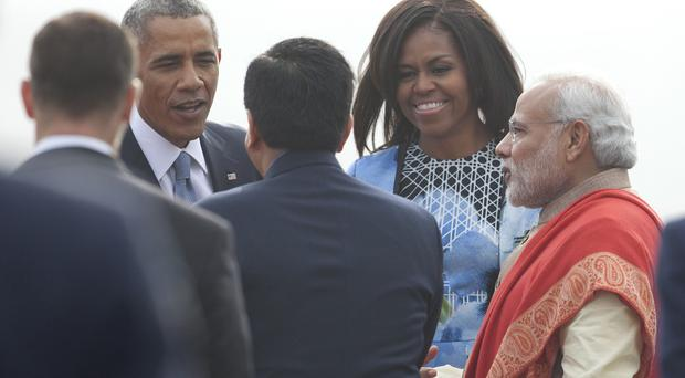 President Barack Obama and first lady Michelle Obama are greeted by Indian Prime Minister Narendra Modi, right (AP)