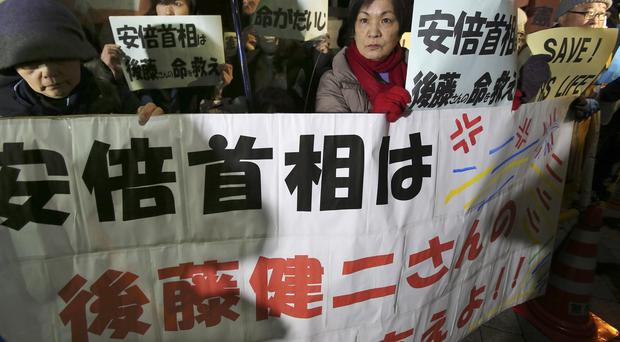 Anti-Shinzo Abe protesters rally in front to the prime minister's official residence in Tokyo (AP)